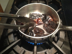 Toasting the chiles gives them a much better flavor. Be careful not to burn them --just a few minutes over medium heat, flipping frequently is enough.