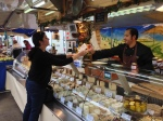 Me buying some chevre at a market along the bank of the river in Lyon.