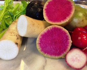 A combination of three radishes: daikon, watermelon and breakfast give this salad flavor and color contrast.